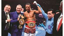 Rosario wins super welterweight titles