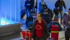 People arrive to Los Angeles International Airport after touchdown of an Air China flight from Beiji