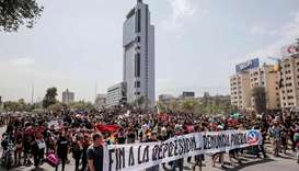 Demonstrators march towards La Moneda presidential palace in Santiago to protest against the Chilean