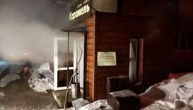 Steam comes out from a door of the Mini Hotel Caramel after a hot water pipe exploded in the night a
