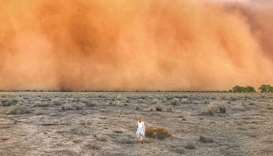 A child running towards a dust storm in Mullengudgery in New South Wales.