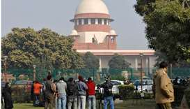 Television journalists are seen outside the premises of the Supreme Court in New Delhi, India
