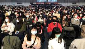 Foxconn employees wearing masks attend the company's year-end gala in Taipei, Taiwan