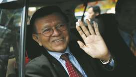 Cambodian opposition leader Kem Sokha leaves the Municipal Court of Phnom Penh yesterday.