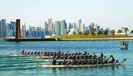 The Doha Skyline serves as a scenic backdrop for the QNB 2020 Qatar Winter Dragon Boat Festival held