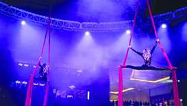 Two acrobats wow mall-goers with their stunts