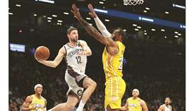 James tallies triple double as Lakers roll over Nets
