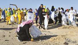 HE Abdullah bin Abdulaziz bin Turki al-Subaie during a cleaning campaign at Zakrit Beach yesterday.