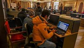 Kashmiri students use the net at an internet centre in Srinagar.