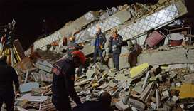 Turkish rescue and police work at the scene of a collapsed building following a 6.8 magnitude earthq