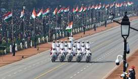 Central Reserve Police Force (CRPF) women motorcycle team members perform during the Republic Day pa