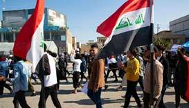 Iraqi students take part in an anti-government demonstration near the headquarters of the local gove