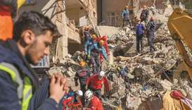 Rescue personnel work amid the rubble of a building in Elazig.