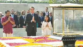 Brazil's President Jair Bolsonaro pays homage at the Mahatma Gandhi memorial at Rajghat in New Delhi