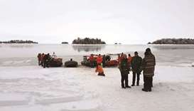 A Surete du Quebec handout image of rescue personnel yesterday stand on the the banks of Lake Saint-