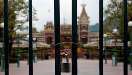 A locked gate is seen after the Hong Kong Disneyland theme park has been closed, following the coron