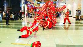 Dragon Parade performers entertain Doha Festival City shoppers on Saturday.