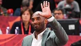 Kobe Bryant waves at the crowd during the Basketball World Cup semi-final game between Australia and