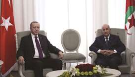 This handout picture taken and released yesterday shows Algerian President Abdelmadjid Tebboune meet
