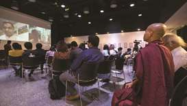 "Audience attend ""Poetry for Humanity"" event in which Rohingya Muslim poets recited poetry via a vide"