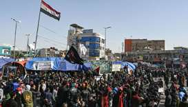 Anti-government protesters gather during a demonstration in the city of Nasiriyah in Iraq's southern