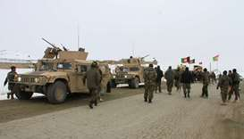 Afghan National Army forces go towards the site of an airplane crash in Deh Yak district of Ghazni p