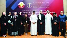 Sheikh Dr Mohamed bin Hamad al-Thani and Faisal Rashid al-Sahouti with other officials after signing