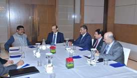 HE al-Kaabi and top Qatari executives with Pradhan