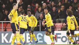 Young guns shine as Arsenal move into fifth round
