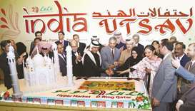 Indian ambassador P Kumaran and Qatari and Indian dignitaries cut a cake to mark the opening of 'Ind
