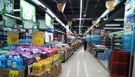 A customer walks in a supermarket in Wuhan, Hubei province, China.