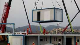 Workers labour at the construction site of the new Huoshenshan Hospital, a makeshift hospital for tr