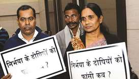A file picture of Nirbhaya's parents Asha Devi and Badri Singh attending a prayer meeting organised