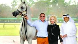 Three-time Platinum World Champion Arabian Hariry Al Shaqab poses at Houston Polo Club with  breeder