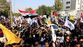 Tens of thousands march in Baghdad to mourn Soleimani, others killed in US air strike