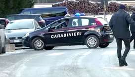 A Carabinieri military police car is seen near the site where suspected drunk driver fatally struck