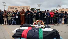 Libyan people mourn during the funeral of people who were killed in an attack on a military academy