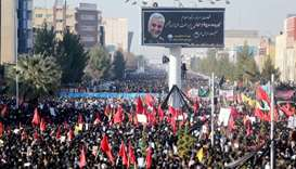 Iranian people attend a funeral procession and burial for Iranian Major-General Qassem Soleimani