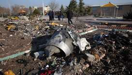 Rescue teams work amidst the debris of crashed Ukraine International Airlines Boeing 737