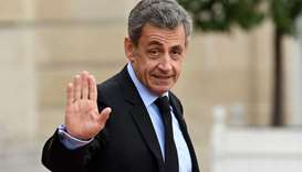 In this file photo taken on September 30, 2019 France's former President Nicolas Sarkozy waves as he