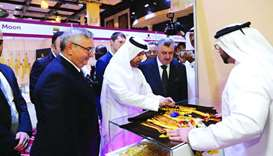 Katara general manager Dr Khalid bin Ibrahim al-Sulaiti and other dignitaries tour the exhibition af