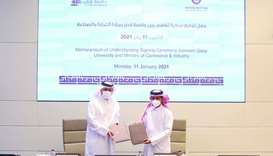Dr Hassan Rashid al-Derham and Sultan bin Rashid al-Khater at the signing ceremony.