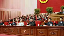 North Korean leader Kim Jong Un (C) attending the 8th Congress of the Workers' Party of Korea (WPK)