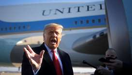 US President Donald Trump speaks to the media before boarding Air Force One to depart Washington on