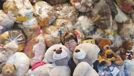 Valeria Schmidt, nicknamed 'Teddy Bear Mama', hugs teddy bears in Harsany, Hungary. The toys are mea