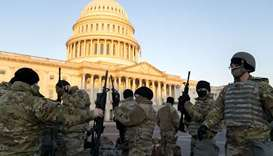 Members of the national guard gather outside the US Capitol.