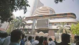 People monitor market news outside the Bombay Stock Exchange in Mumbai (file). The S&P BSE Sensex sl