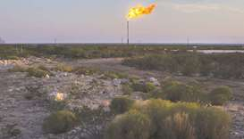 A gas flare burns at dusk in the Permian Basin in Texas (file). US total oil supply will rise by 370