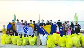 Doha Environmental Actions Project members at a beach cleanup event.