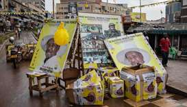 Posters of Uganda President Yoweri Museveni are put in one place the day after the elections on a st